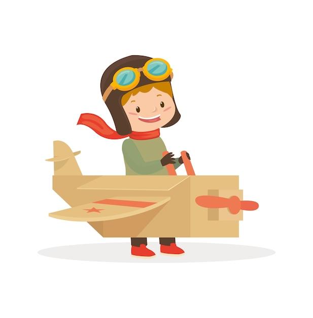 Ein junge benutzt flugzeugspielzeug, um zu spielen Premium Vektoren