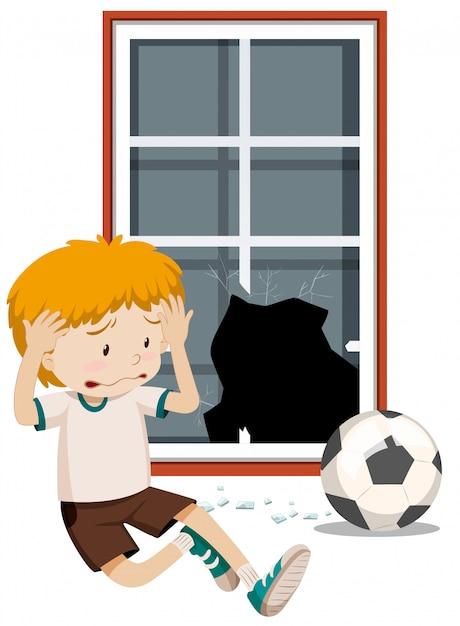 Ein jungenbruchfenster mit fußball Kostenlosen Vektoren