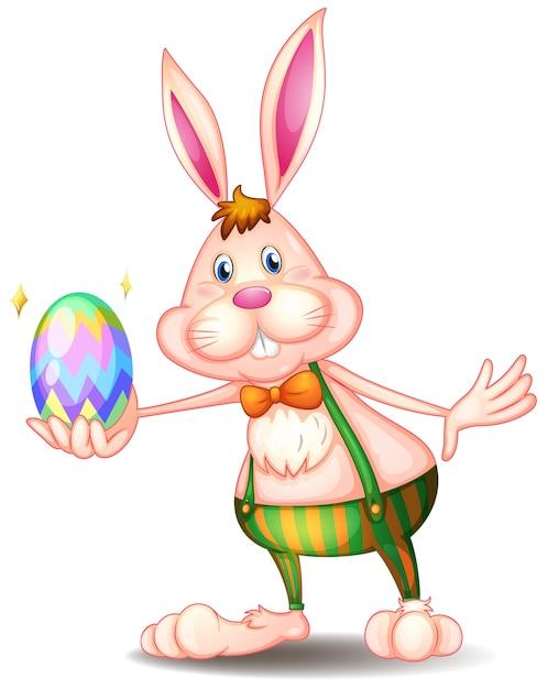 Ein kaninchen, das ein osterei hält Kostenlosen Vektoren