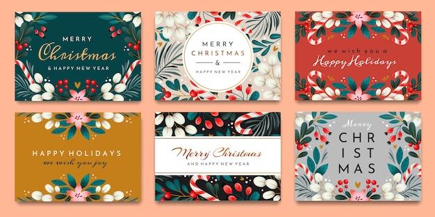 Ein kartensatz mit feiertagsgrüßen. weihnachtskarten mit verzierungen von zweigen, beeren und blättern. Premium Vektoren