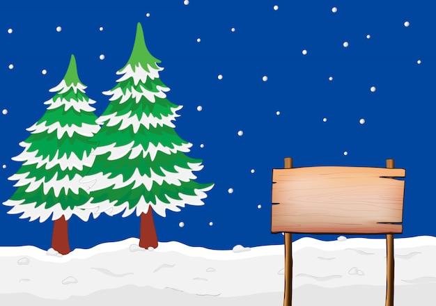Ein leeres schild mit schneebedeckten bäumen Kostenlosen Vektoren