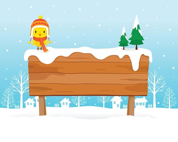 Ein vogel, der wintermütze und schal trägt, thront auf hölzernem schild auf schneehaufen, schneefall, wintersaison Premium Vektoren