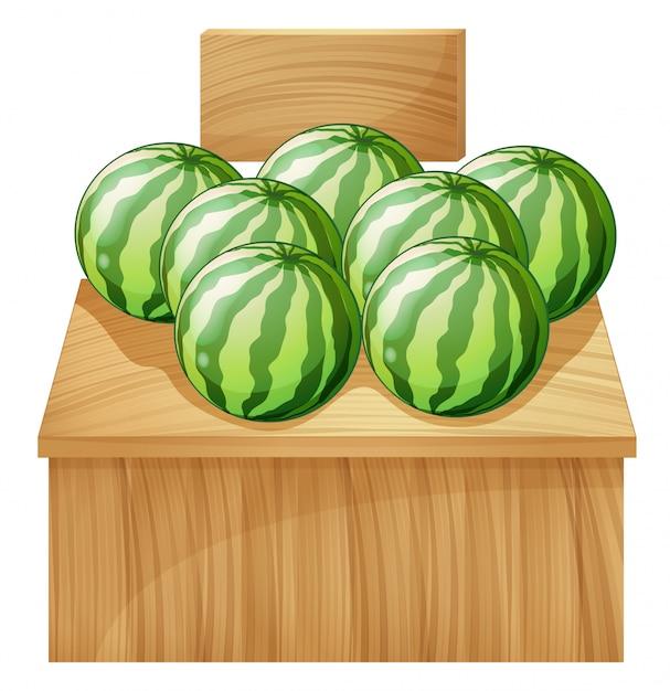 Ein wassermelonenstand mit einem leeren hölzernen schild Kostenlosen Vektoren