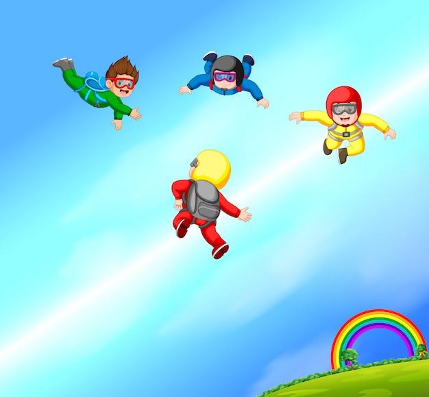 Eine glückliche gruppe von fallschirmspringern Premium Vektoren