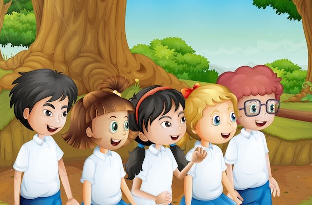Eine gruppe von studenten im wald Premium Vektoren