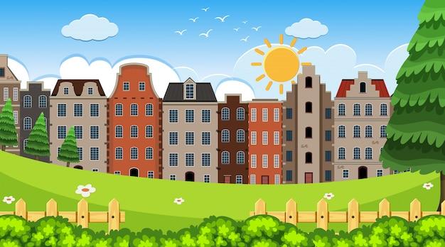 Eine outdoor-szene mit amsterdam house Premium Vektoren