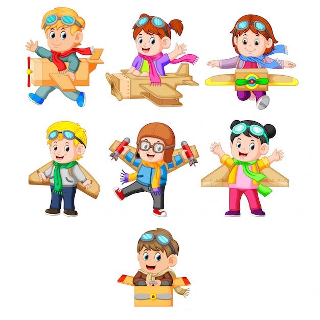 eine Sammlung von Kindern, die mit dem Kartonflugzeug spielen Premium Vektoren