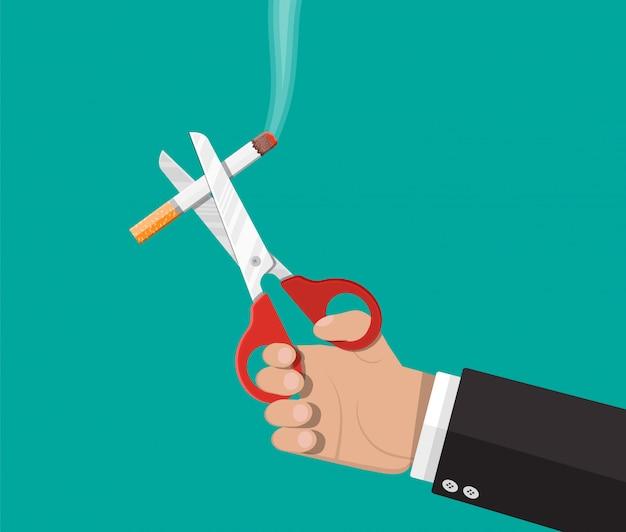 Eine schere in der hand schnitt eine zigarette. Premium Vektoren