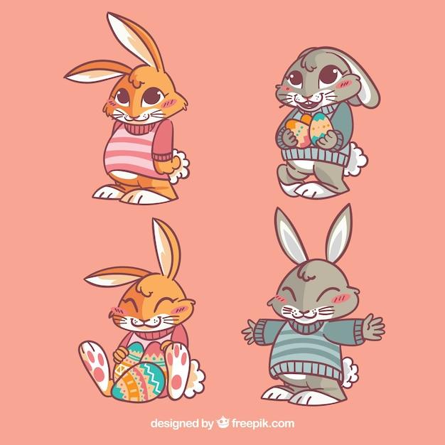 Einige hübsche oster-kaninchen Premium Vektoren