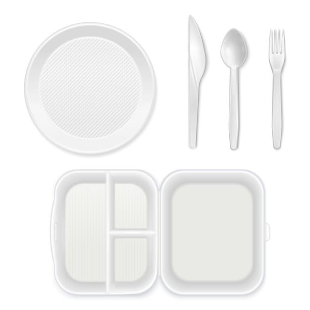 Einweg weiße plastikplatte besteck messer gabel löffel lunchbox draufsicht realistisches geschirr set isoliert Kostenlosen Vektoren