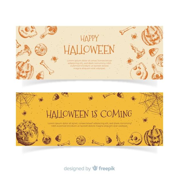 Elegante hand gezeichnete halloween-fahnen Kostenlosen Vektoren