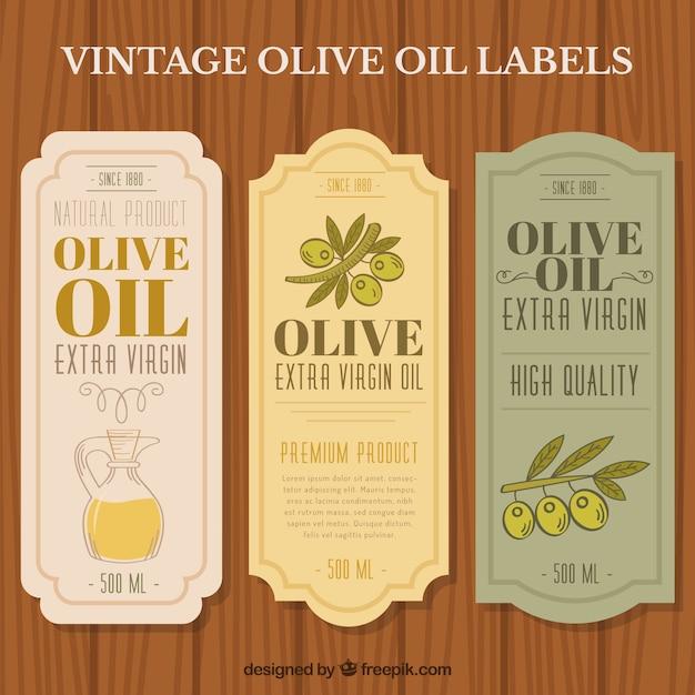Elegante olivenöl aufkleber Kostenlosen Vektoren