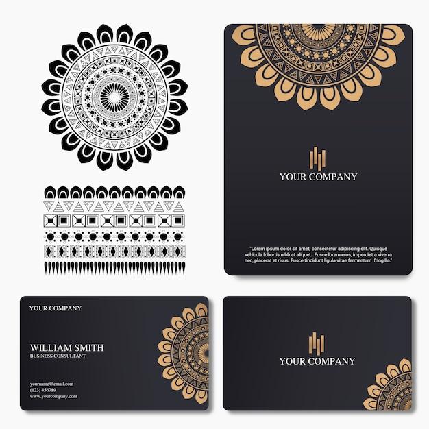 Elegante und luxusvisitenkarte mit mandalaverzierung Premium Vektoren