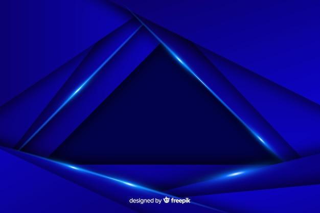 Eleganter dunkler polygonaler hintergrund auf blau Kostenlosen Vektoren