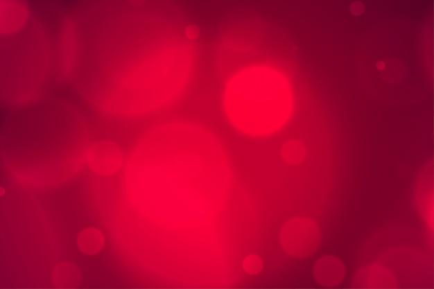 Elegantes verschwommenes rotes bokeh beleuchtet hintergrund Kostenlosen Vektoren