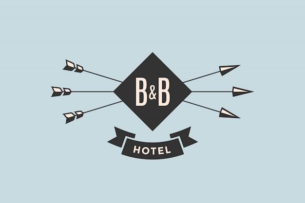 Emblem des hotels mit pfeilen Premium Vektoren