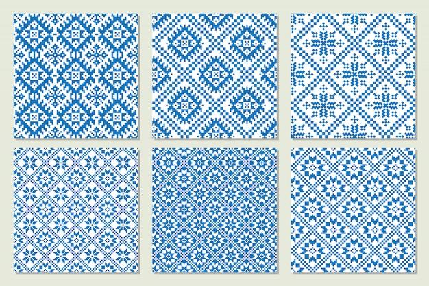 Ethnische nordische muster stellten ansammlung in den blauen und weißen farben ein. vektor-illustration Premium Vektoren