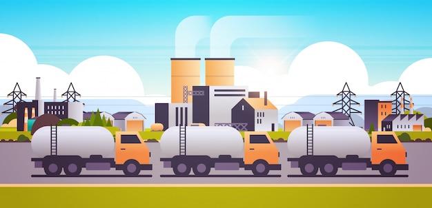 Fabrikgebäude industriegebiet mit gas- oder öltankwagen rohrleitungen schornsteine Premium Vektoren