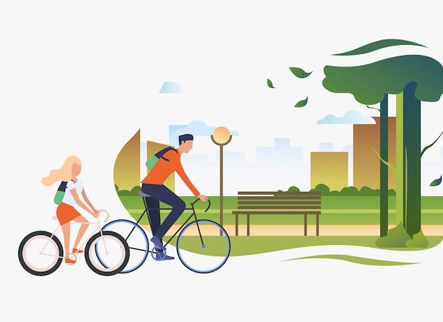 Fahrradfahren des vatis und der tochter, stadtpark mit baum und bank Kostenlosen Vektoren