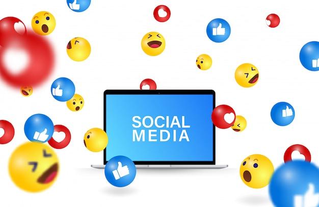 Fallende social-media-emoji, laptop-illustration. computerbildschirm und social-media-symbole und emoji-symbole fallen kommunikationsvisualisierungen Premium Vektoren