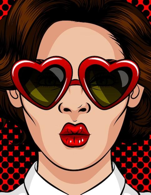 Farbvektorillustration in der pop-arten-art. die frau mit sonnenbrille in form eines herzens. die frau schickt einen kuss. schönheit mit brunettegläsern mit einer art von 60-80s in einem plastikrahmen Premium Vektoren