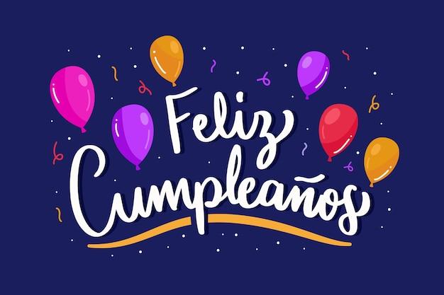 Feliz cumpleaños schriftzug mit luftballons und konfetti Kostenlosen Vektoren