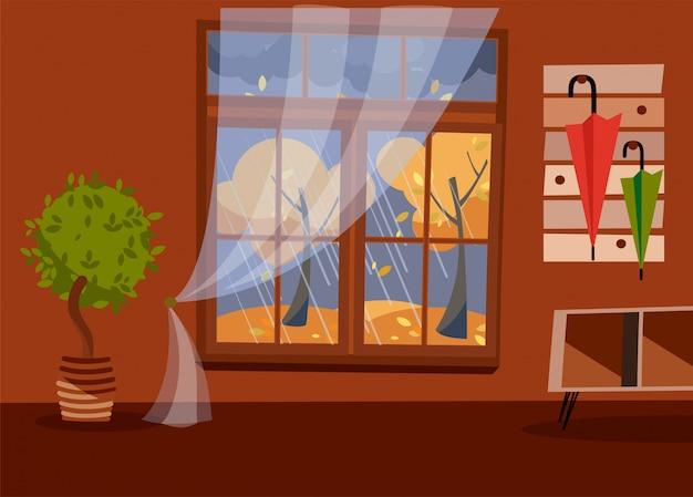 Fenster mit blick auf gelbe bäume und laub. brauner innenraum des herbstes mit regenschirmen auf aufhänger. abends regnerisches wetter draußen. Premium Vektoren