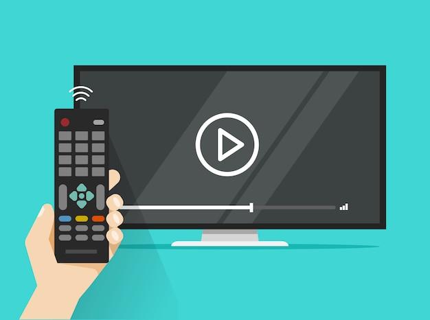 Fernbedienung in der hand nahe flachbildschirm führte fernsehaufpassende flache karikatur des videofilms Premium Vektoren