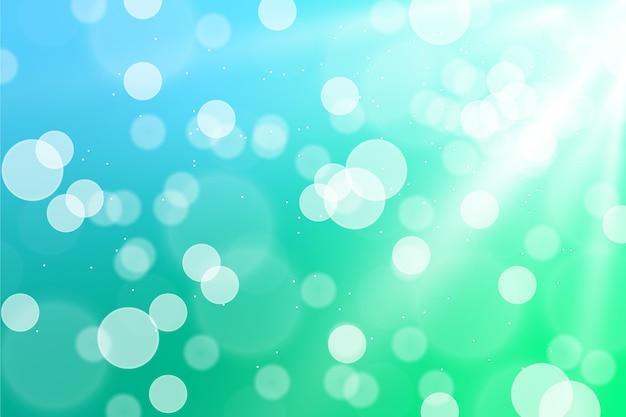 Festlicher hintergrund mit defokussierten lichtern Kostenlosen Vektoren