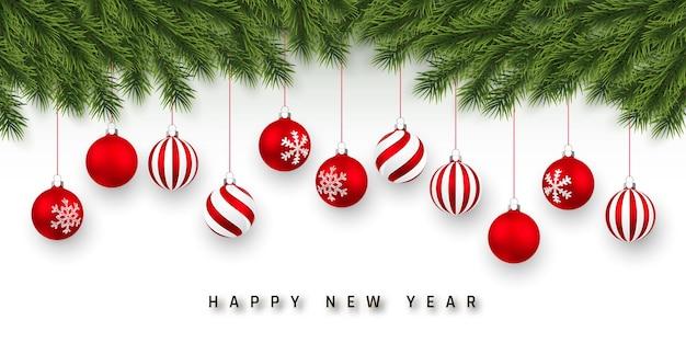 Festlicher weihnachts- oder neujahrshintergrund. weihnachtsbaumzweige und rote weihnachtskugel. Premium Vektoren