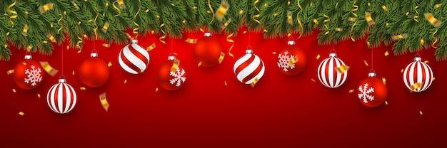 Festliches weihnachtsbanner mit tannenzweigen mit konfetti und weihnachtlichen roten kugeln. Premium Vektoren