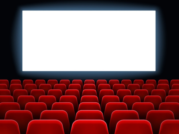 Filmpremiere im kinotheater. weißer leerer bildschirm des kinos am dunklen kinosaalinnenraum mit leeren roten sitzen vector hintergrund Premium Vektoren