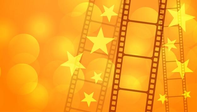 Filmrollestreifen mit sternkino-hintergrund Kostenlosen Vektoren