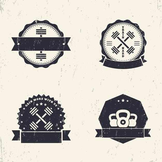 Fitness, fitness-studio-grunge-logos, abzeichen, schilder mit gekreuzten hanteln, illustration Premium Vektoren