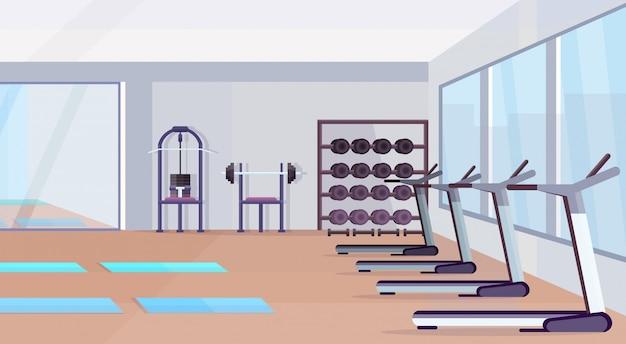 Fitness-halle studio workout-ausrüstung gesunden lebensstil konzept leer keine menschen fitnessstudio interieur mit matten trainingsgerät hanteln spiegel und fenster horizontal Premium Vektoren