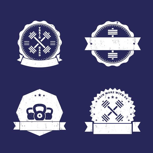 Fitness, turnhalle logos, abzeichen, embleme mit gekreuzten hanteln Premium Vektoren