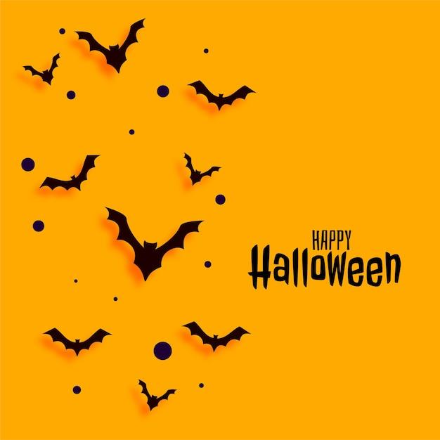 Flache art gelbe glückliche halloween-kartenentwurf Kostenlosen Vektoren
