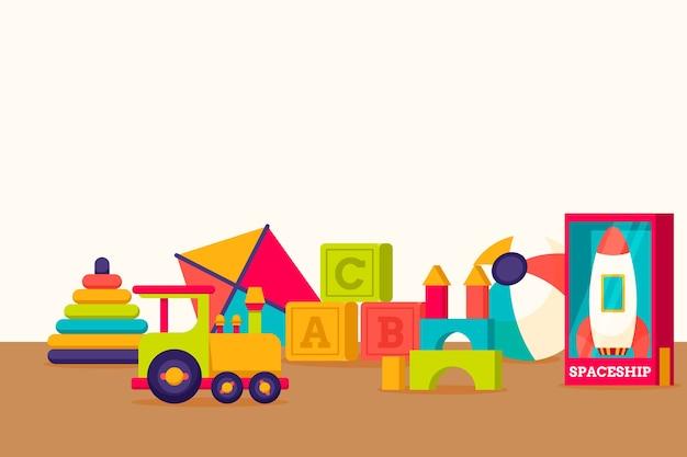 Flache designhintergrund-weihnachtsspielwaren Kostenlosen Vektoren