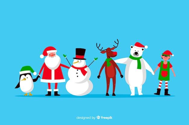Flache weihnachtszeichensammlung auf blauem hintergrund Kostenlosen Vektoren