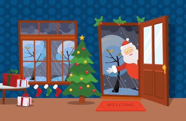 Flache windillustrations-karikaturart. offene tür und fenster mit blick auf die schneebedeckten bäume. weihnachtsbaum, tabellen mit geschenken in den kästen und weihnachtsstrümpfe nach innen. der weihnachtsmann schaut in die tür Premium Vektoren