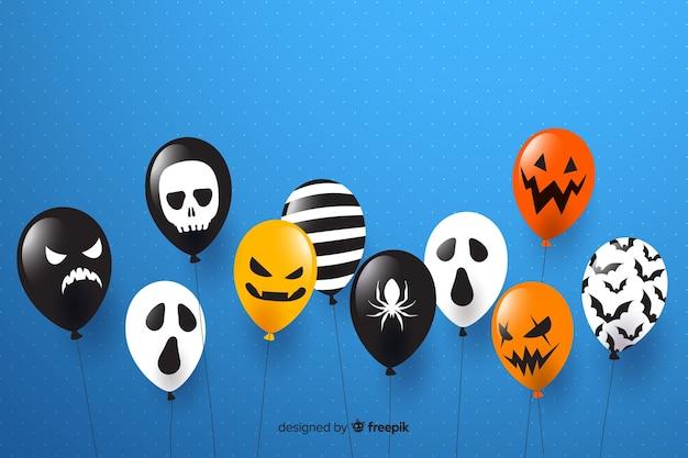 Flacher designhalloween-verkaufshintergrund mit ballonen Kostenlosen Vektoren