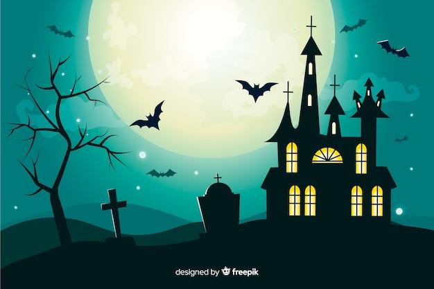 Flacher halloween-hintergrund mit geisterhaus auf vollmond Kostenlosen Vektoren