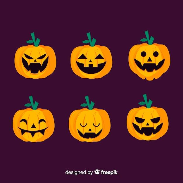 Flacher halloween kürbis jacks o laterne auf violettem hintergrund Kostenlosen Vektoren