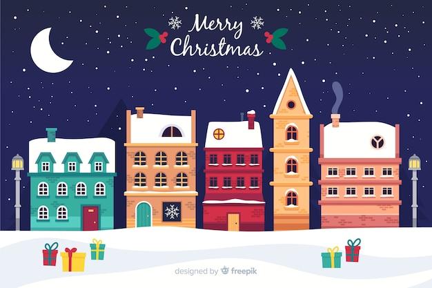 Flaches design weihnachtsstadt hintergrund Kostenlosen Vektoren