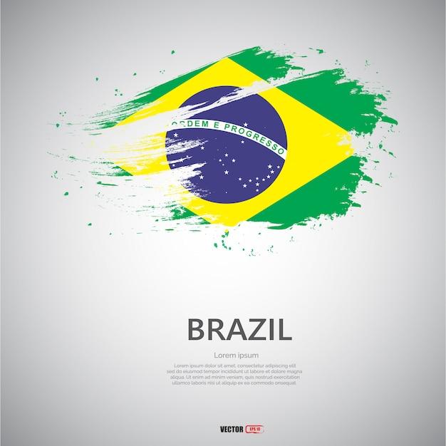 Flagge von brasilien mit pinselstrich. Premium Vektoren