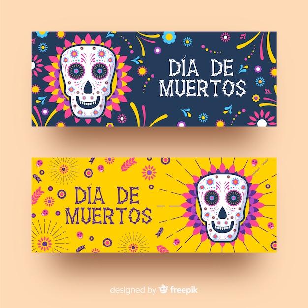 Flat día de muertos banner mit isolierten schädel Kostenlosen Vektoren