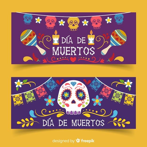 Flat día de muertos banner mit maracas und totenköpfen Kostenlosen Vektoren