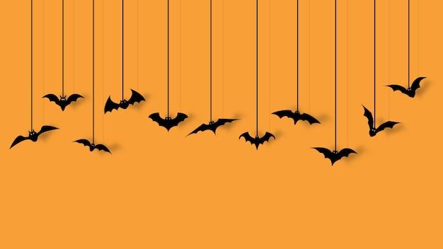 Fledermausdekoration für halloween-partei lokalisiert auf orange hintergrund. Premium Vektoren