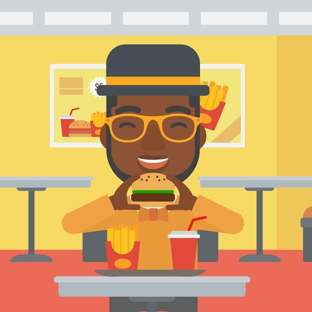 Fleisch fressender hamburger. Premium Vektoren