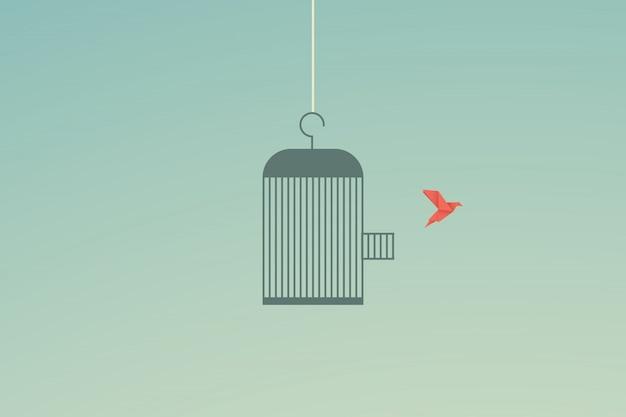 Fliegenvogel und käfig freiheitskonzept Premium Vektoren